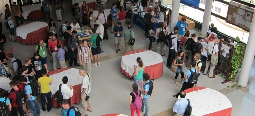 A picture taken at the UseR!2013 conference of attendees during a coffee break